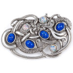 Viking brooch with blue cabs and fire opal cabs